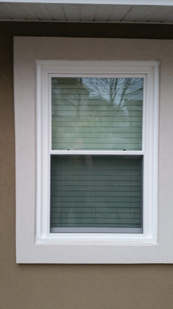 Double Hung Replacement window in Stucco